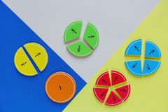 Colorful math fractions on the bright backgrounds. interesting math for kids. Education, back to school concept. Geometry and mathematics materials stock photography