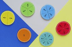 Colorful math fractions on bright colorful background or table. interesting math for kids. Education, back to school concept. Geometry and mathematics royalty free stock photography