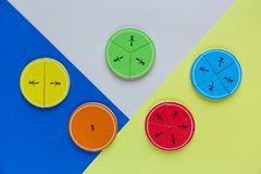 Colorful math fractions on bright colorful background or table. interesting math for kids. Education, back to school concept. Geometry and mathematics stock image