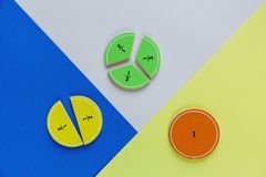 Colorful math fractions on bright colorful background or table. interesting math for kids. Education, back to school concept. Geometry and mathematics royalty free stock image