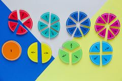 Colorful math fractions on bright colorful background or table. interesting math for kids. Education, back to school concept. Geometry and mathematics stock images