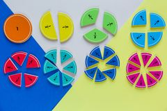 Colorful math fractions on bright colorful background or table. interesting math for kids. Education, back to school concept. Geometry and mathematics royalty free stock images