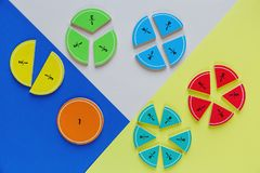 Colorful math fractions on bright colorful background or table. interesting math for kids. Education, back to school concept. Geometry and mathematics royalty free stock photo