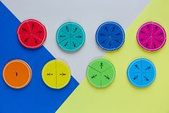 Colorful math fractions on bright colorful background or table. interesting math for kids. Education, back to school concept. Geometry and mathematics royalty free stock photos
