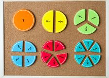 Colorful math fractions on brown wooden background or table. interesting math for kids. Education, back to school concept
