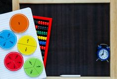 Colorful math fractions and chalkboard. Colorful math fractions on the bright backgrounds. interesting math for kids. Education, back to school concept. Geometry royalty free stock image