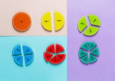 Colorful math fractions on the pink blue violet bright backgrounds. Interesting math for kids. Education, back to school concept. Geometry and mathematics stock image