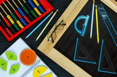 Math fractions back to school. Colorful math fractions on wooden background or table. interesting math for kids. Education, back to school concept. Geometry and royalty free stock photo