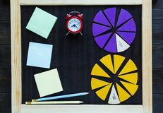 Colorful math fractions on wooden background or table. interesting math for kids. Education, back to school concept. Geometry. And mathematics materials royalty free stock photos