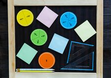 Colorful math fractions on wooden background or table. interesting math for kids. Education, back to school concept. Geometry. And mathematics materials stock photo