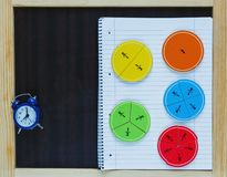 Colorful math fractions on wooden background or table. interesting math for kids. Education, back to school concept. Geometry. And mathematics materials royalty free stock images