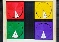 Colorful math fractions on wooden background or table. interesting math for kids. Education, back to school concept. Geometry. And mathematics materials royalty free stock photography