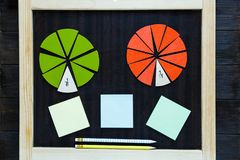 Colorful math fractions on wooden background or table. interesting math for kids. Education, back to school concept. Geometry stock photos