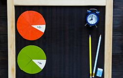 Colorful math fractions on wooden background or table. interesting math for kids. Education, back to school concept. Geometry. And mathematics materials stock photography