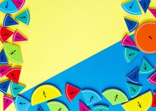 Colorful math fractions on the yellow and blue bright backgrounds. interesting math for kids. Education, back to school concept. G. Eometry and mathematics royalty free stock images