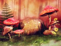 Colorful meadow with red fairy mushrooms Royalty Free Stock Image