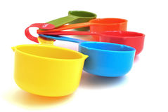 Colorful measuring cups. A set of five dry measuring cup with vibrant colors Royalty Free Stock Photos