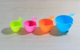 Measuring cups isolated on white wooden table background royalty free stock image