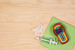 Colorful measuring spoons and Cake decoration icing syringe and Royalty Free Stock Image