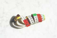Colorful measuring tape metric system rolled up royalty free stock photos