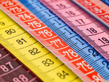 Colorful measuring tapes. Closeup shot from above Stock Photo