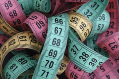 Colorful measuring tapes pile Royalty Free Stock Images