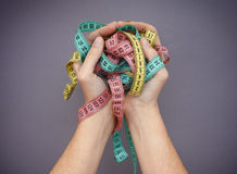 Colorful measuring tapes in woman palms. Diet concept Royalty Free Stock Image