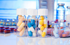 Colorful medical capsules in bottle Royalty Free Stock Image