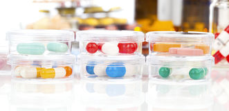 Colorful medical capsules in Petri dishes. Stock Images