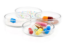 Colorful medical capsules in Petri dishes Royalty Free Stock Image