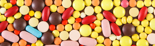 Colorful medical pills and capsules as background, health care concept Royalty Free Stock Images