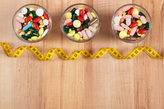 Colorful medical pills and capsules with centimeter, health care and slimming concept, copy space for text Stock Photo