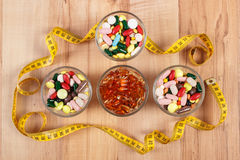Colorful medical pills and capsules with centimeter, health care and slimming concept Royalty Free Stock Image
