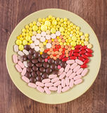 Colorful medical pills, tablets and capsules on plate, health care concept Royalty Free Stock Image