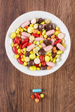 Colorful medical pills, tablets and capsules on plate, health care concept Royalty Free Stock Photo