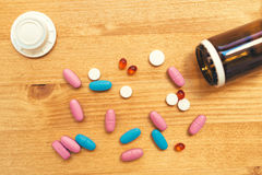 Colorful medical tablets and pills on the desk Stock Photography