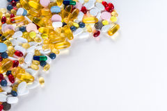 Colorful medication and pills from above on white background with copy space Stock Photo