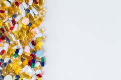 Colorful medication and pills from above on white background with copy space Royalty Free Stock Photos