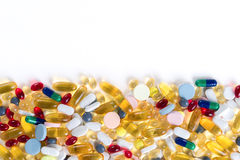 Colorful medication and pills from above on white background. Many different colorful medication and pills from above on white background with copy space Stock Image