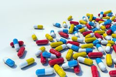 Colorful medicine capsules on light background vector illustration
