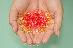 Colorful medicine in hands Stock Photo