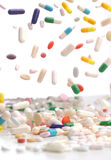 Colorful medicine pills falling. Stock Photo