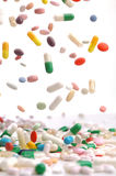 Colorful medicine pills falling. Stock Image