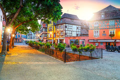 Colorful medieval half-timbered facades with decorated street, Colmar, France Stock Photos