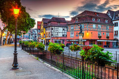 Colorful medieval half-timbered facades with decorated street,Colmar,France Stock Photo