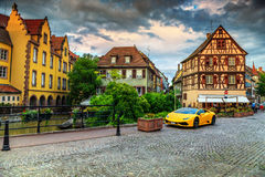 Colorful medieval half-timbered facades with sport car,Colmar,France Stock Photography