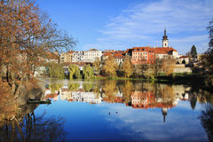 Colorful medieval Town Pisek above the river Otava with its Castle Royalty Free Stock Image