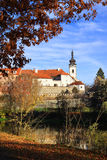 Colorful medieval Town Pisek above the river Otava with its Castle Stock Photography
