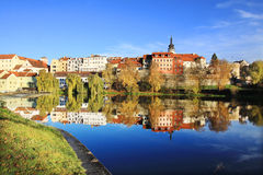 Colorful medieval Town Pisek above the river Otava with its Castle Stock Photo