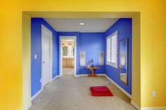 Colorful meditation area in yellow and blue. Royalty Free Stock Photo